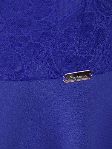 Asymetryczna kreacja wizytowa Tomera VI, elegancka kreacja z kokardą.