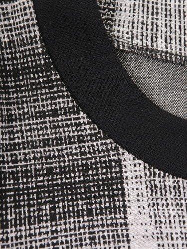 Elegancka sukienka wykończona czarnymi lamówkami Szarlota I