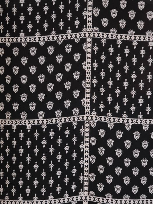 Elegancka tunika z ozdobnym wiązaniem w pasie 26953