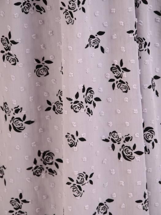 Rozkloszowana sukienka w kwiaty, kreacja z ozdobnym wiązaniem 30525