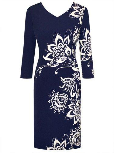 Sukienka damska Odetta, jesienna kreacja z wyszczuplającym wzorem.