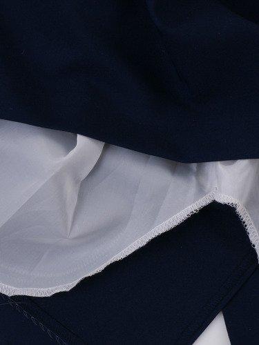 Sukienka wyszczuplajaca Sandria II, wiosenna kreacja z geometrycznym kołnierzem.